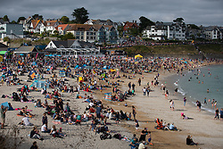 © Licensed to London News Pictures. 14/08/2018. Falmouth, UK. Large crowds gather on Gyllyngvase beach in Falmouth to watch The Red Arrows perform a display as part of Falmouth Week in Cornwall. Large crowds are expected, as 45,000 people watched last year. Photo credit : Tom Nicholson/LNP