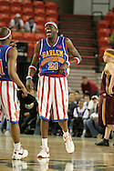 "04 May 2006: Kevin ""Special K"" Daley (21) laughs it up with a fellow trotter during the Harlem Globetrotters vs the New York Nationals at the Sulivan Arena in Anchorage Alaska during their 80th Anniversary World Tour.  This is the first time in 10 years that the Trotters have visited Alaska."