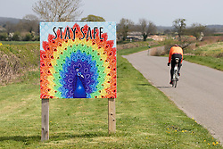 © Licensed to London News Pictures. 13/04/2020. Ratcliffe Culey, Warwickshire, UK. A brightly painted Stay Safe sign outside a farm in Ratcliffe Culey, Warwickshire. Photo credit: Dave Warren / LNP