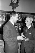 13/02/1963<br /> 02/13/1963<br /> 13 February 1963<br /> Retirement presentation at Gilbeys of Ireland Ltd., Dublin. A presentation of a cheque for £100 and a gold watch was made to Paddy Slater (65), on his retirement after 49yrs and 7 months service with the company. A sum of money was also presented by the staff. Picture shows: Mr. Ian Cairnduff, Director Gilbeys (left) presenting the watch to Mr. Slater.