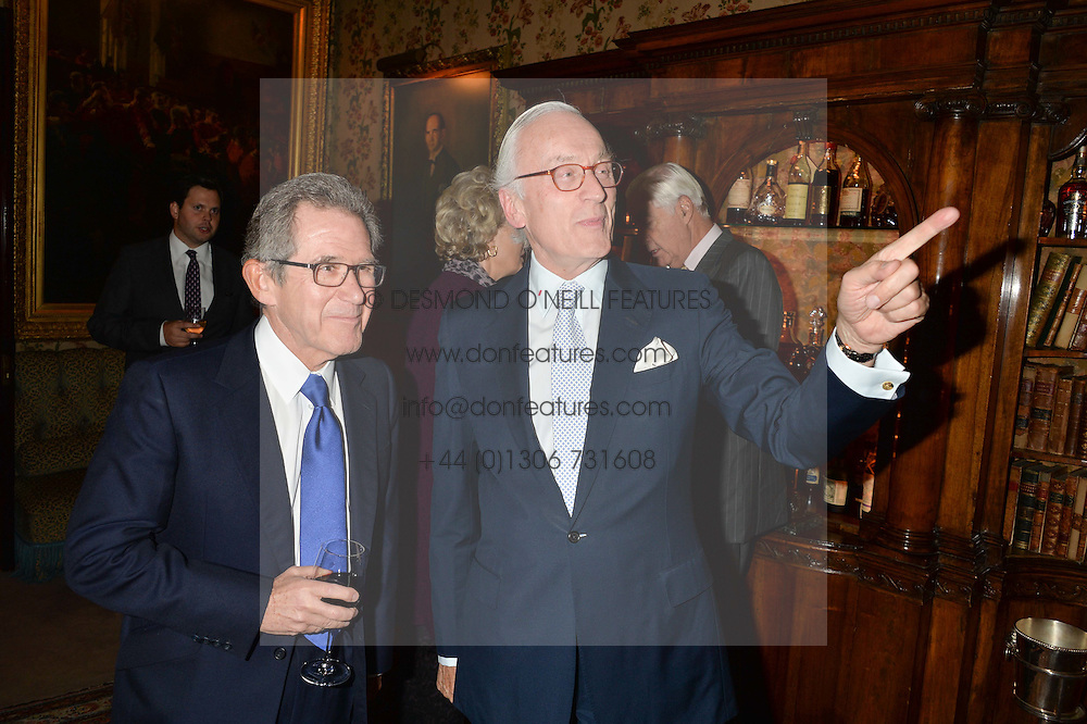 Left to right, LORD BROWNE and LORD CHADLINGTON at a party to celebrate the publication of Right or Wrong: The Memoirs of Lord Bell held at Mark's Club, Charles Street, London on 16th October 2014.