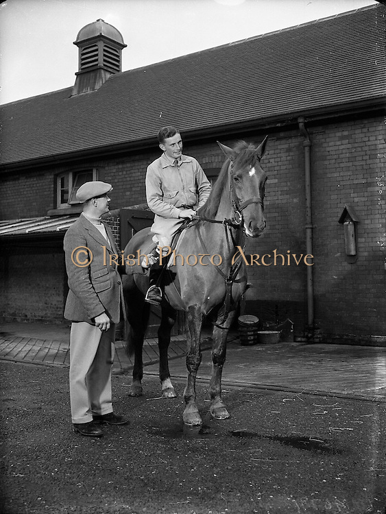 03/01/1957<br /> 01/03/1957<br /> 03 January 1957<br /> <br /> Army Equitation School Feature - New Civilian Trainer, Seamus Hayes (left) and Billy Ringrose (on horse)