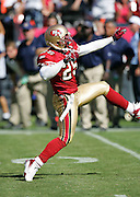 SAN FRANCISCO - SEPTEMBER 17:  Safety Chad Williams #25 of the San Francisco 49ers high steps and pumps his fists and arms in celebration after one of his two sacks against the St. Louis Rams at Monster Park on September 17, 2006 in San Francisco, California. The Niners defeated the Rams 20-13. ©Paul Anthony Spinelli *** Local Caption *** Chad Williams