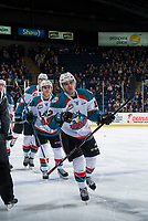 KELOWNA, CANADA - MARCH 7: Erik Gardiner #12 and Leif Mattson #28 of the Kelowna Rockets skate to the bench to celebrate a goal against the Vancouver Giants  on March 7, 2018 at Prospera Place in Kelowna, British Columbia, Canada.  (Photo by Marissa Baecker/Shoot the Breeze)  *** Local Caption ***