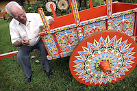 Carlos Chaverri, 78, decorates a traditional car at his Traditional Car Factory in Sarchi, about 50 km  north of San Jose, Costa Rica on Friday November 25, 2005. The Caverri's family own this factory and shop since 1903. This kind of painted car is a symbol of the folk culture in Costa Rica. UNESCO recognize this cars as Humankind Nonmaterial Patrimony.  (Photo/Cristobal Herrera).