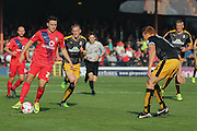 York City forward, on loan from Oldham Athletic, Rhys Turner takes on Cambridge United defender Mark Roberts  during the Sky Bet League 2 match between York City and Cambridge United at Bootham Crescent, York, England on 3 October 2015. Photo by Simon Davies.