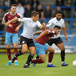 TELFORD COPYRIGHT MIKE SHERIDAN Adam Walker of Telford and Ellis Deeney of Telford close down Liam Agnew of Gateshead during the National League North fixture between AFC Telford United and Gateshead FC at the New Bucks Head Stadium on Saturday, August 10, 2019<br /> <br /> Picture credit: Mike Sheridan<br /> <br /> MS201920-005