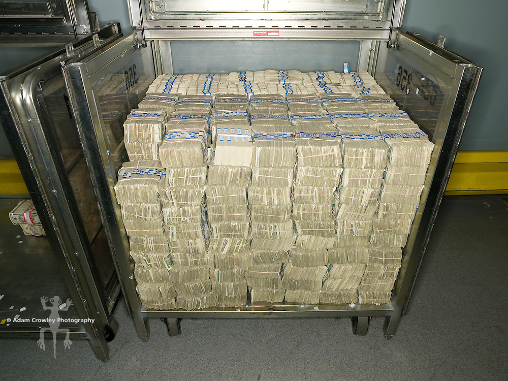 Bundles of U.S. dollar bills stacked in a rolling container called a truck, at the U.S. Federal Reserve Bank of Chicago.