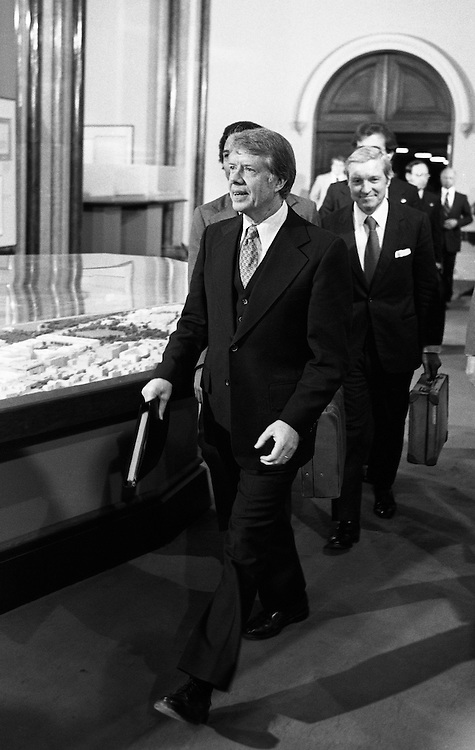 President Jimmy Carter and advisors walk into a meeting at The Smithsonian Institution's Castle building. 1978 - To license this image, click on the shopping cart below -