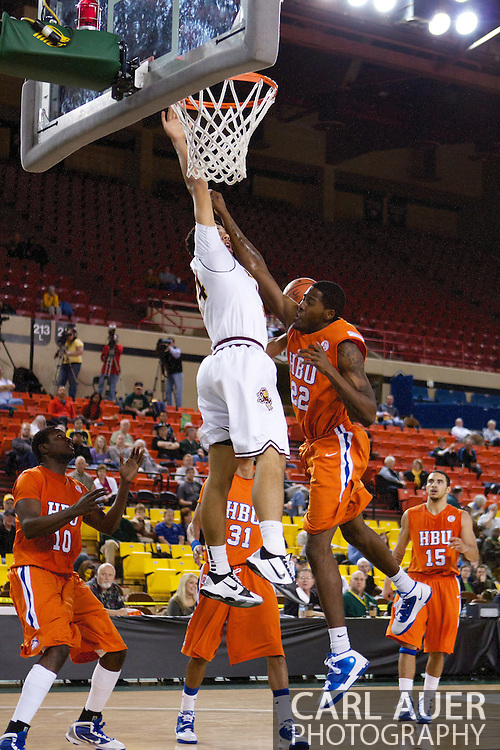 November 25th, 2010:  Anchorage, Alaska - Arizona States Trent Lockett (24) gets fouled hard as he attempts a dunk in the Sun Devils 73-55 win over Houston Baptist in their first round game of the Great Alaska Shootout.