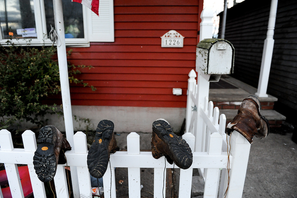 Work boots dry on a fence in the water-logged community of Broad Channel, Queens, following Hurricane Sandy, Nov. 3, 2012.