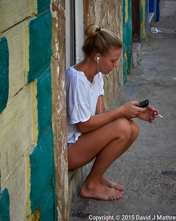 Music and Cigarette. Morning Walkabout in Old Havana. Image taken with a Leica T camera and 23 mm f/2 camera.
