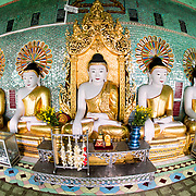 Standing high on a hill in Sagaing, the OoHminThoneSel Pagoda features a long, curved alcove lined with dozens of statues of the Buddha. After recent ongoing renovations and upgrades made possible by donors, the pagoda is ornately decorated with colorful tile mosaics and fresh, bright paint.