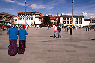 Pilgrims at Barkhor Square, Lhasa - Barkhor Square is an area of narrow streets and a public square located around Jokhang Monastery in Lhasa. <br /> The square has been the most important devotional circumabulation for Tibetan pilgrims for centuries as it still is today. The walk was is about one kilometre long and encircles the entire Jokhang,  Most of the tiny alleys have been demolished in recent years and replaced with wider streets and new buildings by the Chinese government.