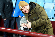 A Dad and his young son from Newcastle during the Premier League match between Aston Villa and Newcastle United at Villa Park, Birmingham, England on 25 November 2019.