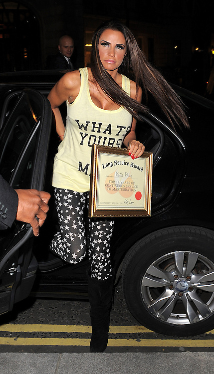 Model Katie Price arriving at the Corinthia Hotel holding a certificate with the words 'Long Service Award, awarded to Katie Price For 17 Years Of Continuous Service To Masturbation' signed by Keith Lemon. London, UK. 10/10/2012<br />BYLINE MUST READ : GOTCHAIMAGES.COM<br /><br />Copyright by &copy; Gotcha Images Ltd. All rights reserved.<br />Usage of this image is conditional upon the acceptance <br />of Gotcha Images Ltd, terms and conditions available at<br />www.gotchaimages.com