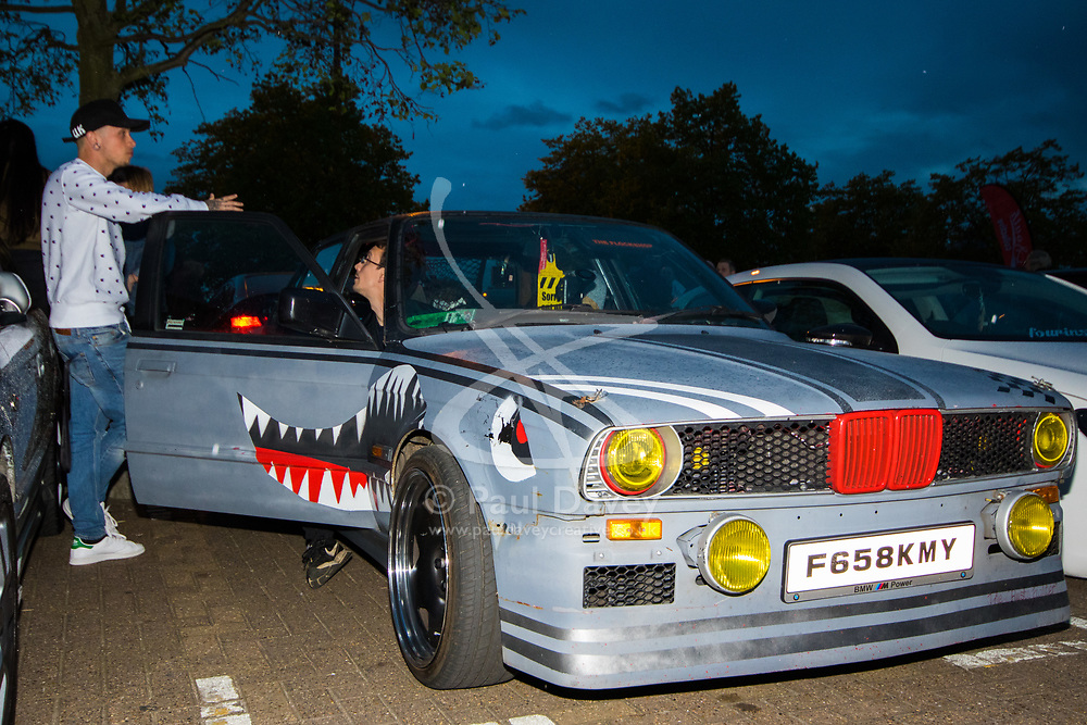 London, April 16th 2017. Hundreds of car enthusiasts gather with their souped up vehicles for the '2017 Tunnel Run', an where they take to the streets of London for a high speed 'cruise' through several of its tunnels and over bridges, cruising past famous landmarks. With complaints from some members of the public over noise and road safety grounds, police keep an eye on the drivers with the threat of siezing cars from unruly drivers. The event begins with a static meet-up at Canada Water before the cars set off on their cruise through the streets of the capital. PICTURED: A 'rat car' BMW.<br /> <br /> Credit: ©Paul Davey