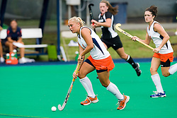 Virginia Cavaliers midfielder/foward Traci Ragukas (9) in action against Providence College.  The Virginia Cavaliers field hockey team defeated the Providence College Friars on the University Hall Turf Field on the Grounds of the University of Virginia in Charlottesville, VA on August 31, 2008.