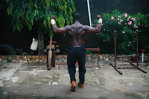 A bodybuilder trains in a local gym in the Ghana capital Accra which is a hotbed of boxing gyms. Photographed for Men's Health UK
