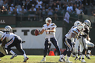 OAKLAND, CA - OCTOBER 10: Philip Rivers #17 of the San Diego Chargers in action against the Oakland Raiders at Oakland-Alameda County Coliseum on October 10, 2010 in Oakland, California. (Photo by Tom Hauck) Player: Philip Rivers