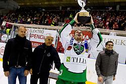 Ales Music (HDD Tilia Olimpija, #16) and Matjaz Rakovec, president of HZS,  with trophy after ice-hockey match between HK Acroni Jesenice and HDD Tilia Olimpija in fourth game of Final at Slovenian National League, on April 2, 2012 at Dvorana Podmezaklja, Jesenice, Slovenia. HDD Tilia Olimpija won 5:2 and become national champions in season 2011/12. (Photo By Matic Klansek Velej / Sportida.com)