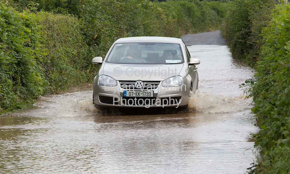 20/8/2009.A car tries to get through flood waters at Dinan Dunmore just north of Kilkenny City yesterday..Picture Dylan Vaughan.