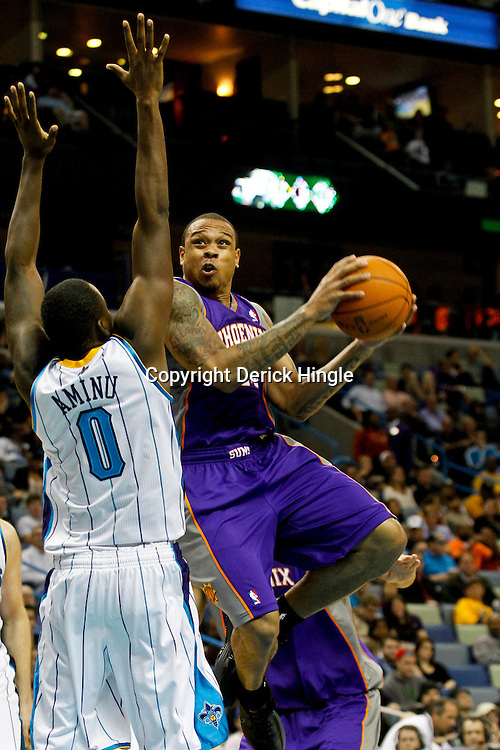December 30, 2011; New Orleans, LA, USA; Phoenix Suns point guard Shannon Brown (26) shoots over New Orleans Hornets small forward Al-Farouq Aminu (0) during the second half of a game at the New Orleans Arena. The Suns defeated the Hornets 93-78.   Mandatory Credit: Derick E. Hingle-US PRESSWIRE