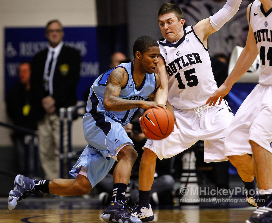 INDIANAPOLIS, IN - FEBRUARY 02: Mike Powell #1 of the Rhode Island Rams dribbles the ball against Rotnei Clarke #15 of the Butler Bulldogs at Hinkle Fieldhouse on February 2, 2013 in Indianapolis, Indiana. Butler defeated Rhode Island 75-68. (Photo by Michael Hickey/Getty Images) *** Local Caption *** Mike Powell; Rotnei Clarke