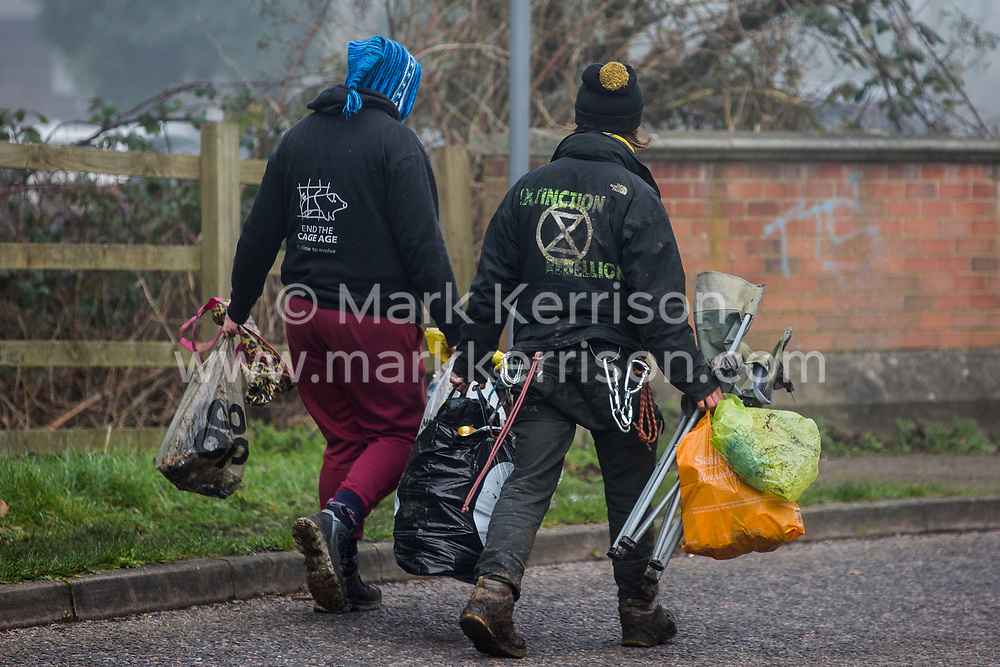 Denham, UK. 6 February, 2020. Extinction Rebellion activists pick up litter near to works associated with the HS2 high-speed rail link alongside the river Colne at Denham Ford. Works planned in the immediate vicinity include the felling of trees and the construction of a Bailey bridge, compounds and fencing, some of which in a wetland nature reserve forming part of a Site of Metropolitan Importance for Nature Conservation (SMI).