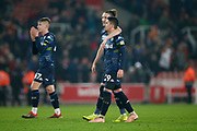Disappointed Leeds United defender Luke Ayling (2) and Leeds United midfielder Pablo Hernandez (19)  at full time during the EFL Sky Bet Championship match between Stoke City and Leeds United at the Bet365 Stadium, Stoke-on-Trent, England on 19 January 2019.