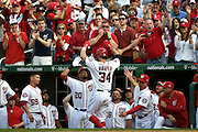 Apr 6, 2015; Washington, DC, USA; -- Washington Nationals left fielder Bryce Harper (34) is greeted by teammates after hitting a solo home run in the fourth inning in Opening Day game against the New York Mets  at Nationals Park.  Mandatory Credit: H.Darr Beiser-USA TODAY Sports ORG XMIT: USATSI-213368 ORIG FILE ID:  20150406_krj_usa_334.JPG