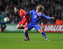 Gareth Bale (Tottenham Hotspur) of Wales battles for the ball with Luka Modric (Real Madrid) of Croatia - Photo mandatory by-line: Joe Meredith/JMP - Tel: Mobile: 07966 386802 26/03/2013 - SPORT - FOOTBALL -  Liberty Stadium - Swansea -  Wales V Croatia - WORLD CUP QUALIFIER