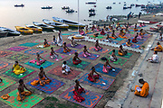 Yoga classes at dawn on the ghats of the Ganges River at Varanasi.