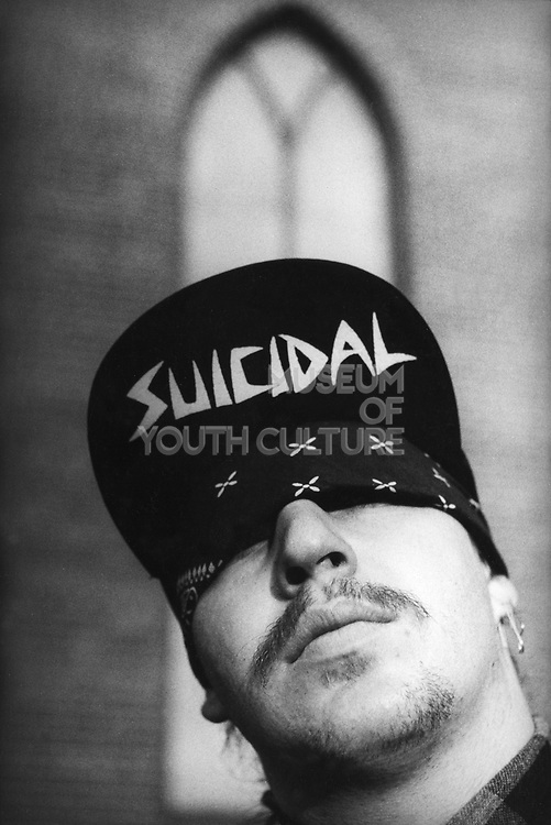 A man wearing a Suicidal Tendencies Cap, with a bandana covering his eyes, USA, 1980's.