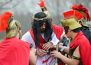 Roberto Marquez, of Bensalem, Pennsylvania portrays Jesus as he has his garments stripped during the Stations of the Cross leading to his crucifixion on Good Friday April 3, 2015 at Our Lady of Fatima in Bensalem, Pennsylvania.  (Photo by William Thomas Cain/Cain Images)