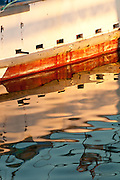 Reflections of a boat in Pillar Point Harbor, Half Moon Bay, California