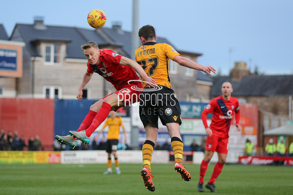 Newport County midfielder, on loan from Crystal Palace, Connor Dymond  beats York City defender, on loan from Burnley, Luke Hendrie in the air during the Sky Bet League 2 match between York City and Newport County at Bootham Crescent, York, England on 16 January 2016. Photo by Simon Davies.
