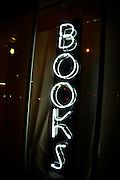 A neon sign in a bookstore.