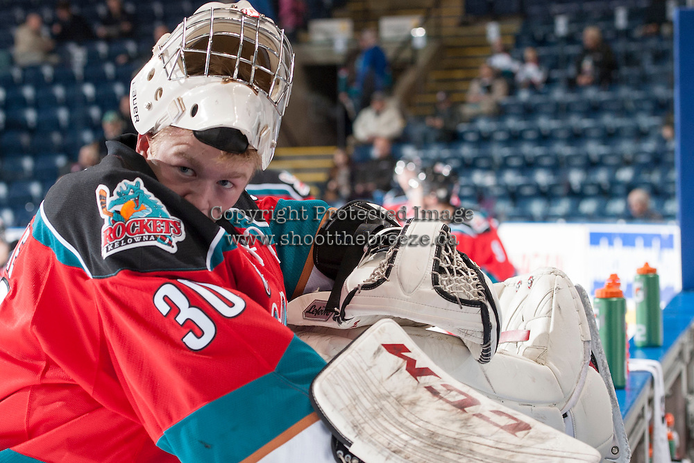 KELOWNA, CANADA - NOVEMBER 30: Jordon Cooke #30 of the Kelowna Rockets stretches during warm up against the Kamloops Blazers on November 30, 2013 at Prospera Place in Kelowna, British Columbia, Canada.   (Photo by Marissa Baecker/Shoot the Breeze)  ***  Local Caption  ***