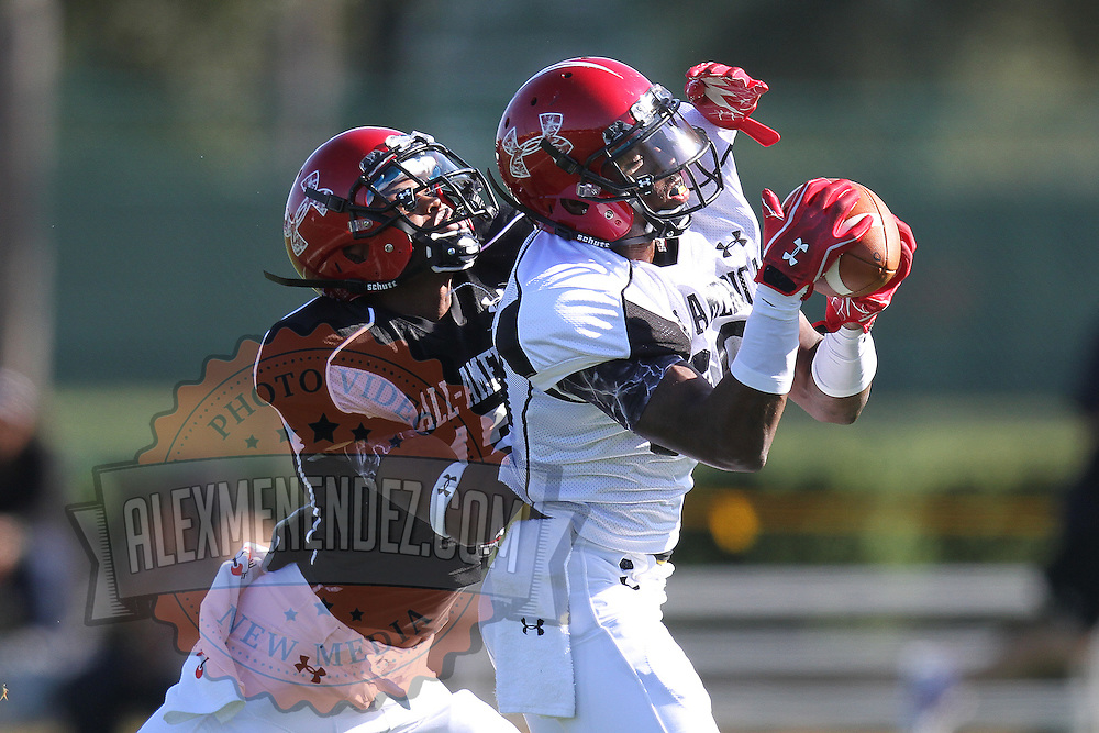 Jarvis Landry (R) makes a catch against Marcus Roberson (L) during the practice session at the Walt Disney Wide World of Sports Complex in preparation for the Under Armour All-America high school football game on December 3, 2011 in Lake Buena Vista, Florida. (AP Photo/Alex Menendez)