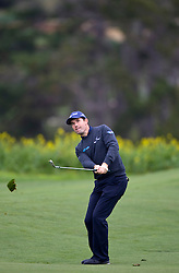 February 12, 2010; Pebble Beach, CA, USA; Padraig Harrington hits a wedge shot from the fairway for a birdie on the sixth hole during the second round of the AT&T Pebble Beach Pro-Am at Pebble Beach Golf Links.