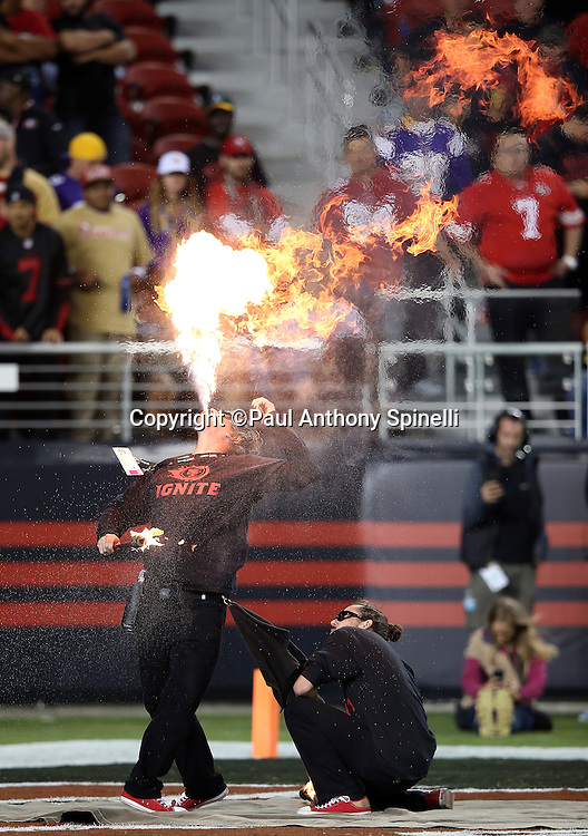 Members of the San Francisco 49ers Ignite team do a fire breathing performance during the San Francisco 49ers 2015 NFL week 1 regular season football game against the Minnesota Vikings on Monday, Sept. 14, 2015 in Santa Clara, Calif. The 49ers won the game 20-3. (©Paul Anthony Spinelli)