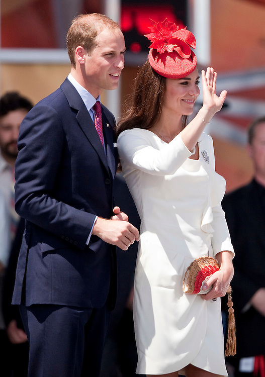 Britain's Prince William and Catherine the Duchess of Cambridge wave to the crowd following Canada Day celebrations on Parliament Hill in Ottawa, Canada, July 1, 2011. The duke and Duchess are on a nine day tour of Canada, their first official foreign trip as husband and wife.<br /> AFP PHOTO/GEOFF ROBINS