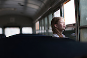 Morgan Bleeker looks out the window of a school bus in Solon, Iowa on Tuesday, March 8, 2016.