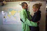 Actievoerder Sini Sareela van de Arctic 30 (rechts) wordt omhelst in Beverwijk. In IJmuiden is de Arctic Sunrise, het schip van milieuorganisatie Greenpeace dat een jaar door Rusland in beslag is genomen, aangekomen. De voormalige ijsbreker wordt in Amsterdam uit het water gehaald en opgeknapt omdat het gehavend is geraakt toen het aan de ankers lag. De boot van de milieuorganisatie is september 2013 door de Russen geënterd en de bemanningsleden vastgezet op verdenking van piraterij. Greenpeace voerde actie bij een boorplatform in de Barentszzee. Als het schip weer is gerepareerd, wil de milieubeweging weer campagnes houden met de Artic Sunrise.<br /> <br /> In IJmuiden, the Arctic Sunrise, the Greenpeace ship that a year ago is seized by Russia, arrived. The former ice breaker is removed from the water in Amsterdam and refurbished since it was damaged when it was up to the anchors. The boat of the environmental organization is boarded in September 2013 by the Russians and the crew put down on suspicion of piracy. Greenpeace campaigned on a drilling platform in the Barents Sea. If the ship is repaired, the environmental movement wants to use the Arctic Sunrise again for campaigning.