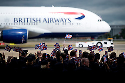 © London News Pictures. 04/07/2013 . London, UK.  British Airways staff wave union flags as the new British Airways AIRBUS A380 superjumbo arrives at Heathrow Airport. It was the first time British Airlines have taken delivery of the new plane, making British Airways the first European airline to operate both the 787 and A380. Photo credit : Ben Cawthra/