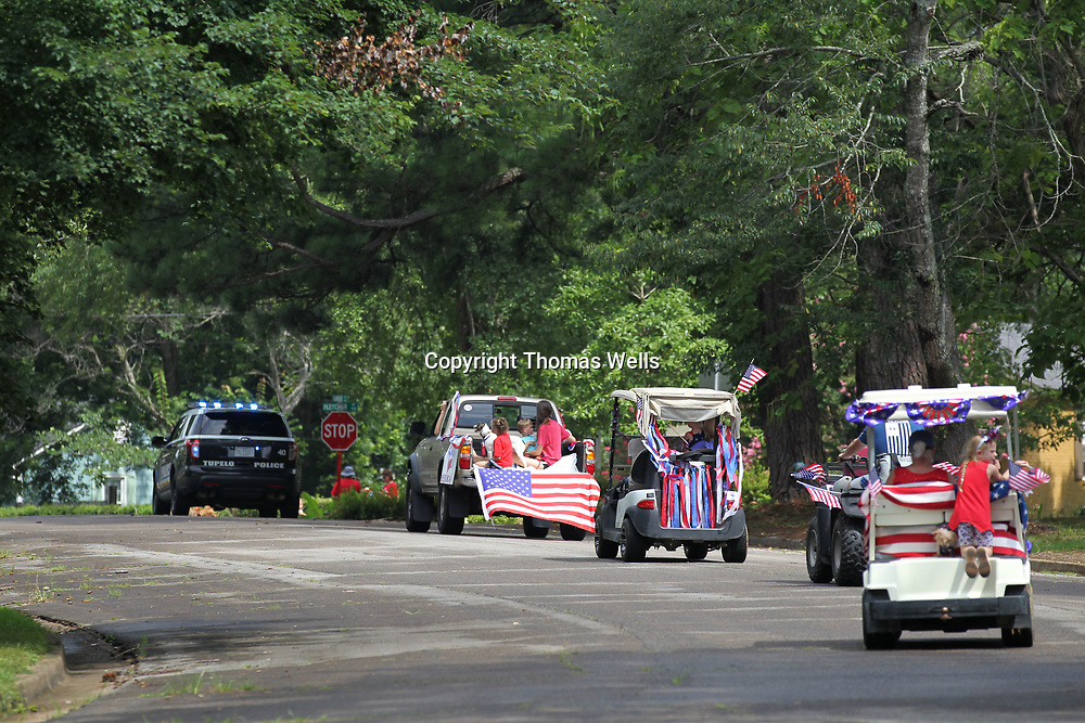 The parade winds through the streets in the Joyner neighborhood.