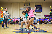 Milpitas High School juniors and sophomores (pink) compete for the last chair during Musical Chairs during the annual Trojan Olympics, where students compete in various unorthodox events for class bragging rights, at Milpitas High School in Milpitas, California, on March 27, 2015. (Stan Olszewski/SOSKIphoto)