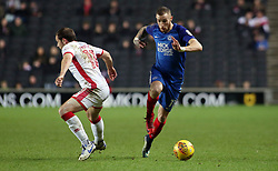 Marcus Maddison of Peterborough United skips past Peter Pawlett of Milton Keynes Dons - Mandatory by-line: Joe Dent/JMP - 30/12/2017 - FOOTBALL - Stadium MK - Milton Keynes, England - Milton Keynes Dons v Peterborough United - Sky Bet League One