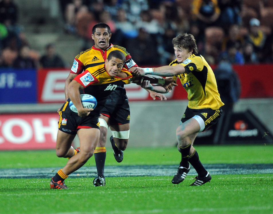 Chiefs Augustine Pulu is grabbed by the Hurricanes Beauden Barrett in the Super 15 Rugby match, Waikato Stadium, Hamilton, New Zealand, Saturday, April 28, 2012. Credit:SNPA / Ross Setford